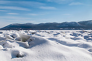 New Windsor, New York - Snow and ice cover the Hudson River in a view from Plum Point on Feb. 24, 2015. The moutains over the Hudson Highlights on the other side of the river are in the background.