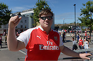 an Arsenal fan outside Emirates Stadium before k/o. Barclays Premier League, Arsenal v West Ham Utd at the Emirates Stadium in London on Sunday 9th August 2015.<br /> pic by John Patrick Fletcher, Andrew Orchard sports photography.