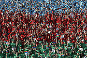 Baku, Azerbaijan, 13/10/2003..Crowds in the colours of the Azerbaijan national flag at the final campaign rally of Azeri Prime Minister Ilham Aliyev in the forthcoming Presidential elections. Ilham is the son of  current President Heidar Aliyev, who is apparently being treated in a US hospital after suffering a heart attack, although there is speculation that he is in fact already dead...........