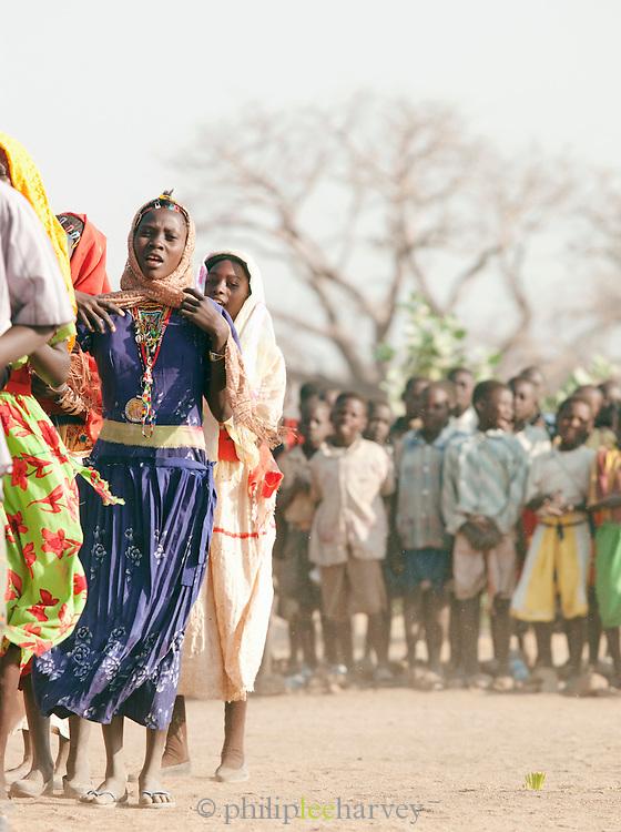 Children of the Nuba tribe performing a welcome dance at their school in Nyaro village, Kordofan region, Sudan