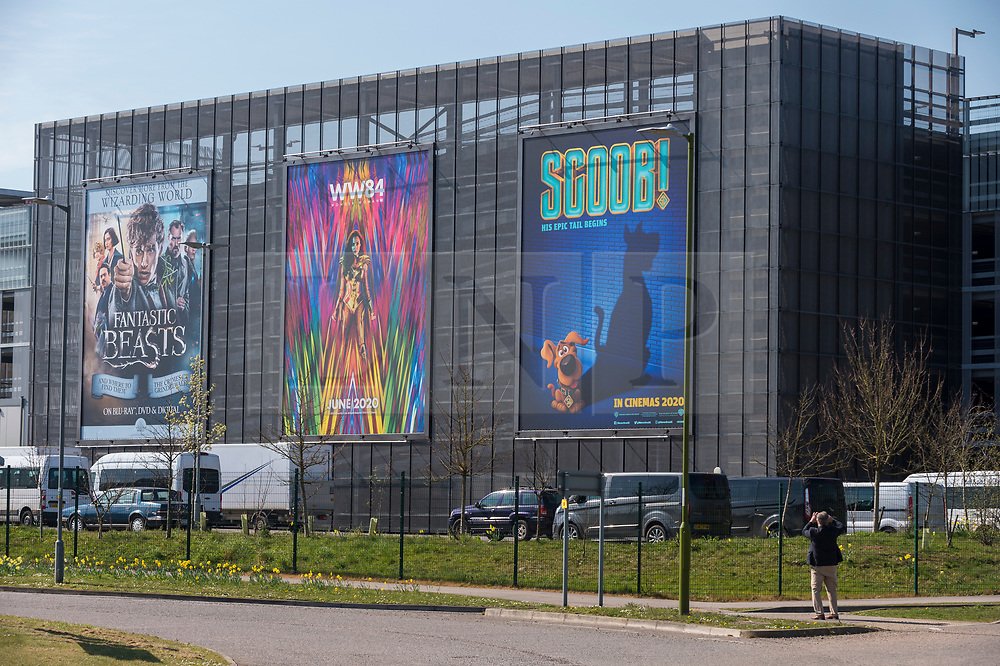 © Licensed to London News Pictures. 26/03/2020. WATFORD, UK.  A general view of movie signage outside th entrance to Warner Bros. Studios in Leavesden, Hertfordshire, just outside London, home to the Harry Potter, Fantastic Beasts and recent Mission Impossible movies.  Work on productions has all but ceased due to the coronavirus pandemic.  Workers in the industry comprise mainly the self-employed (from cameramen to background artistes) and later today Rishi Sunak, Chancellor of the Exchequer, is due to launch a financial support plan for them and members of the self employed in other industries.  Photo credit: Stephen Chung/LNP