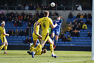 AFC Wimbledon defender(on loan from Birmingham City) Steve Seddon (15) heads the ball during the EFL Sky Bet League 1 match between Oxford United and AFC Wimbledon at the Kassam Stadium, Oxford, England on 13 April 2019.