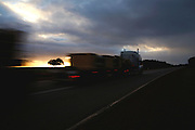 A roadtrain truck. Tourists driving in australian roads should drive carefully when crossing with these  cargo transport so typical of the country roads.