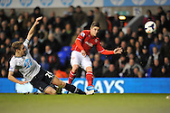Cardiff's Declan John striking the ball passed Totthenham's Capt Michael Dawson . Barclays Premier League , Tottenham Hotspur v Cardiff city at White Hart Lane in London, England on Sunday 2nd March 2014.<br /> pic by John Fletcher, Andrew Orchard sports photography.
