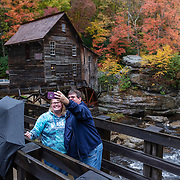 Connie Briles and Tony McCullough of Charleston, W.VA.,  snap a selfie together at the Glade Creek Grist Mill inside Babcock State Park near Clifftop, W.Va., on Saturday, October 27, 2018.