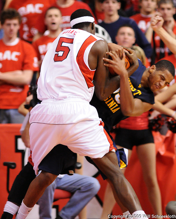 Feb 22, 2009; Piscataway, NJ, USA; West Virginia forward Wellington Smith (35) and wrestles for a jump ball against Rutgers center Hamady N'Diaye (5) during the second half of Rutgers' 74-56 loss to West Virginia at the Louis Brown Athletic Center.