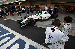 William's Felipe Massa is waved out of the garage by his son before the Abu Dhabi Grand Prix at the Yas Marina Circuit, Abu Dhabi.