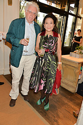 JUNG CHANG and JON HALLIDAY at a party to celebrate the publication of India Hicks: Island Style hosted by Princess Marie-Chantal of Greece, Saffron Aldridge and Amanda Brooks has held at Ralph Lauren, 105-109 Fulham Road, London on 28th April 2015,
