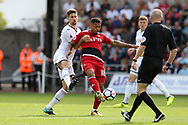 Andre Gray of Watford © is challenged by Federico Fernandez of Swansea City (l) . Premier league match, Swansea city v Watford at the Liberty Stadium in Swansea, South Wales on Saturday 23rd September 2017.<br /> pic by  Andrew Orchard, Andrew Orchard sports photography.
