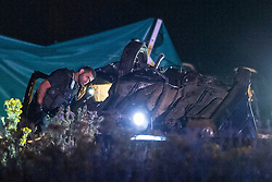 © Licensed to London News Pictures . 21/07/2014 . Ranby , UK . Emergency services examine wreckage at the scene where three people have died in a crash involving a number of vehicles on the A1 road at Ranby, near Worksop, Nottinghamshire this morning (21/07/2014). Photo credit : Joel Goodman/LNP