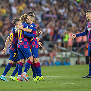 BARCELONA, SPAIN - August 25:  Antoine Griezmann #17 of Barcelona is congratulated by Jordi Alba #18 of Barcelona after scoring his first league goal for the club during the Barcelona V  Real Betis, La Liga regular season match at  Estadio Camp Nou on August 25th 2019 in Barcelona, Spain. (Photo by Tim Clayton/Corbis via Getty Images)