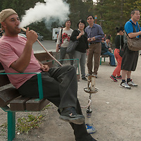 A youngster shocks other tourists by smoking a hookah in Banff National Park, Alberta, Canada.
