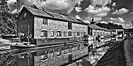 British Waterways transported coal and other commodities through this canal system. Oxen, on the pathway along side the canal, pulled the boats. A locks system regulated the water level and boat traffic.  Aspect Ratio 1w x 0.50h