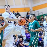 Miyamura Patriot Jason Cordova (22) elevates to score on the Thoreau Hawks during the Wingate Holiday Classic basket ball tournament at Wingate High School Thursday.
