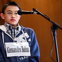 031314       Cable Hoover<br /> <br /> Spelling bee champion Alessandro Bolus steps up to the microphone as the announcer gives him a word during a spelling bee at St Michael Indian School Thursday.