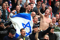 Ajax fans hold a Israel flag in the stands during the Champions League, Semi Final, First Leg at the Tottenham Hotspur Stadium, London.