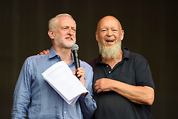Labour leader Jeremy Corbyn and Michael Eavis speak on the Pyramid Stage during the Glastonbury Festival at Worthy Farm in Pilton, Somerset. Picture date: Saturday June 24th, 2017. Photo credit should read: Matt Crossick/ EMPICS Entertainment.