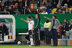 11.10.2011, Esprit Arena, Duesseldorf, GER, UEFA EURO 2012 Qualifikation, Deutschland (GER) vs Belgien (BEL), im Bild Ilkay Guendogan / Gündogan (#19 GER, Borussia Dortmund), Joachim Jogi Löw / Loew (Bundestrainer / Trainer GER) // during the UEFA Euro 2012 qualifying round Germany vs Belgium  at Esprit Arena, Duesseldorf 2011-10-11 EXPA Pictures © 2011, PhotoCredit: EXPA/ nph/  Kurth       ****** out of GER / CRO  / BEL ******