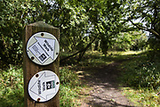 A signpost indicates two wildlife walks at Calvert Jubilee Nature Reserve on 27 July 2020 in Calvert, United Kingdom. On 22nd July, the Berks, Bucks and Oxon Wildlife Trust BBOWT reported that it had been informed of HS2's intention to take possession of part of Calvert Jubilee nature reserve, which is home to bittern, breeding tern and some of the UK's rarest butterflies, on 28th July to undertake unspecified clearance works in connection with the high-speed rail link.