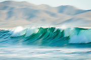 The waves at Los Cerritos came rolling in on a sunny and warm March afternoon.  The winter waves in Baja aren't necessarily their best of the year, but they still offer surfers a terrific ride with a dramatic mountainous backdrop.