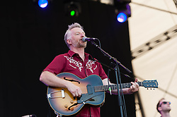 © Licensed to London News Pictures. 18/07/2014. Southwold, UK.   Billy Bragg performing live at Latitude Festival 2014 on Day 1.  The Latitude Festival is a British annual music festival.  Photo credit : Richard Isaac/LNP