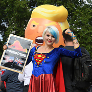 Anti-Brexit Madeleina Kay against Trump 'baby' blimp fly over Parliament Square Gardens on July 2018, London, UK.
