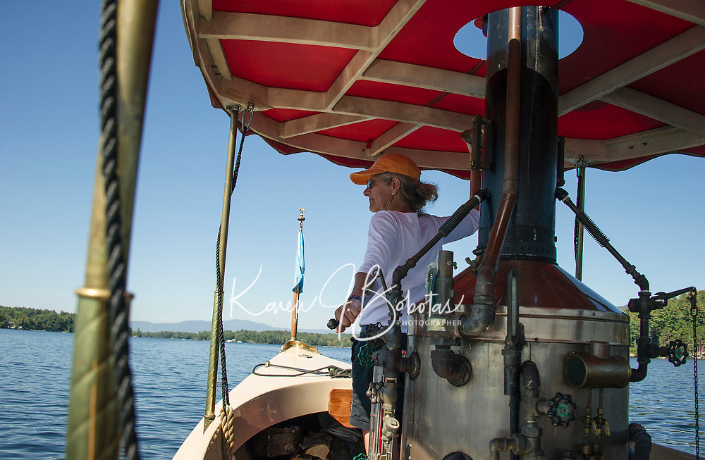 """Blowing the steam whistle of the """"Phoenix"""" to a fellow steam boater while heading towards Lees Mill from 19 Mile Bay on Lake Winnipesaukee.  (Karen Bobotas Photographer)"""