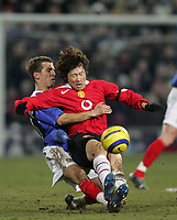 Photo: Lee Earle.<br /> Portsmouth v Manchester United. The Barclays Premiership. 11/02/2006. Portsmouth's Gary O'Neil (L) slides in on Ji-Sung Park.