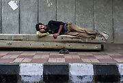 16th August 2014,New Delhi. A man sleeps on concrete posts on a pavement in New Delhi, India on the 16th August 2014<br /> <br /> Sleeping in the outdoors is common in Asia due to a warmer climate and the fact that personal privacy for sleep is not so culturally ingrained as it is in the West. New Delhi (where most of these images were taken) is a harsh city both in climate and environment and for those working long hours, often in hard manual labour, sleep and rest is something fallen into when exhaustion overwhelms, no matter the place or circumstance. Then there are the homeless, in Delhi figures for them from Government and NGO sources vary wildly from 25,000 to more than 10 times that. Others public sleepers may simply be travellers having a siesta along the way.<br />  <br /> <br /> PHOTOGRAPH BY AND COPYRIGHT OF SIMON DE TREY-WHITE, photographer in Delhi<br /> <br /> + 91 98103 99809<br /> email: simon@simondetreywhite.com