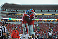 Mississippi Rebels wide receiver Damore'ea Stringfellow (3) makes a 20 yard touchdown catch against Vanderbilt Commodores cornerback Torren McGaster (5) and celebrates with Mississippi Rebels tight end Jeremy Liggins (15) with 2:13 remaining in the first quarter at Vaught-Hemingway Stadium at Ole Miss in Oxford, Miss. on Saturday, September 26, 2015. (AP Photo/Oxford Eagle, Bruce Newman)