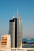 High rise modern building in Downtown Haifa, Israel. The Haifa port is in the background