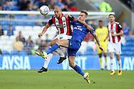Samir Carruthers of Sheffield United (l) is challenged by Joe Ralls of Cardiff City ®. EFL Skybet championship match, Cardiff city v Sheffield Utd at the Cardiff City Stadium in Cardiff, South Wales on Tuesday 15th August 2017.<br /> pic by Andrew Orchard, Andrew Orchard sports photography.