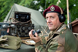 A reenactor portrays a radio operator of the 21st Independent Parachute Company at the Northallerton Wartime Weekend.18th and 19th June  2011.<br /> Image © Paul David Drabble