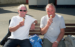 © Licensed to London News Pictures. 28/03/2012..Saltburn, England..As temperatures rise this week the beach at Saltburn in Cleveland attracts the visitors as they enjoy the warm weather. At left Freddie Smith and Billy Drawbridge from Redcar enjoy an ice cream after walking along the beach to Saltburn from Redcar...Photo credit : Ian Forsyth/LNP
