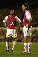 Photo. Greig Cowie<br />Arsenal v Roma. UEFA Champions League. 11/03/2003<br />Sylvain WIltord and Robert Pires look dejected after Arsenal conceded a goal