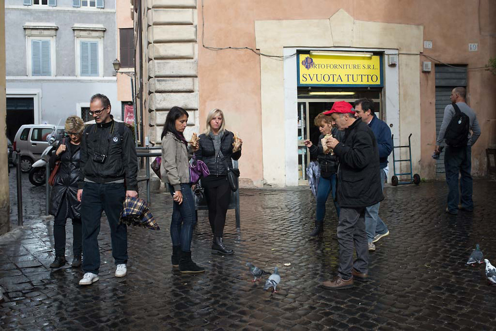 People break for lunch just off a plaza in Rome, Italy