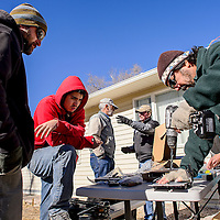 011014       Cable Hoover<br /> <br /> Volunteers Joe Urycki, left, Mitchell Runkles and Chris Chavez prepare some of the electrical components for installation during a joint Gallup Solar and Habitat for Humanity project in Gallup Friday.