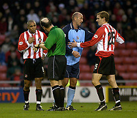 Photo. Glyn Thomas.<br /> Sunderland v Coventry City. Nationwide Division 1.<br /> Stadium of Light, Sunderland. 08/11/03.<br /> Sunderland's Jeff Whitley (L) argues with referee Butler after being awarded a yellow card and Coventry's Gary McAllister has a heated dispute with Colin Healy.