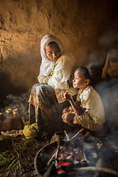Ramla Sharif and her daughter Siam roasts coffee inside her home in the village of Choche in Ethiopia. Legend has it this is the birthplace of coffee. The region is home to the largest pool of genetic diversity in the world of coffee. It is home to more genetic diversity in coffee than the rest of the producing countries combined by a huge margin.