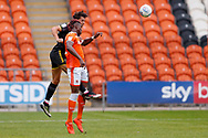 Wimbledon defender Will Nightingale (5) wins the header  during the EFL Sky Bet League 1 match between Blackpool and AFC Wimbledon at Bloomfield Road, Blackpool, England on 20 October 2018.