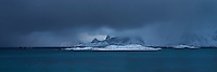 Winter storm coveres distant mountains over Ytresand beach, Moskenesøy, Lofoten Islands, Norway