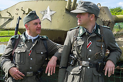 Reenactors portraying Members of 1 Kompanie Großdeutschland beside one of the display tanks at Fort Paull<br /> <br />   04May 2015<br />   Image © Paul David Drabble <br />   www.pauldaviddrabble.co.uk