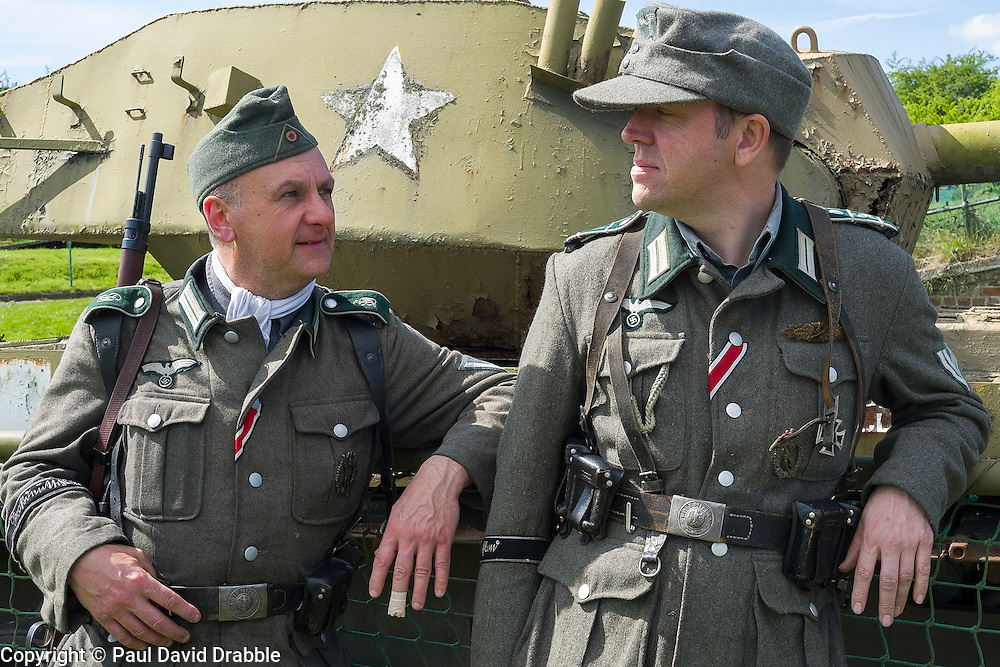 Reenactors portraying Members of 1 Kompanie Großdeutschland beside one of the display tanks at Fort Paull<br /> <br />   04May 2015<br />   Image © Paul David Drabble <br />   www.pauldaviddrabble.co.uk