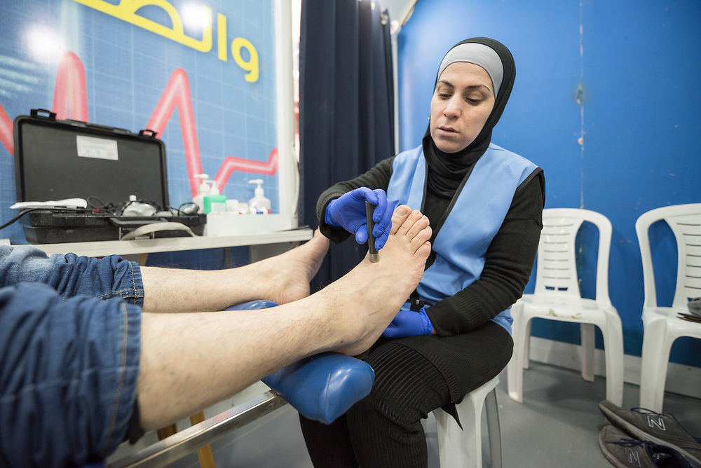 26 February 2020, Abu Dis, Palestine: Nurse Najwa Hawamdeh administers a foot exam of patient 49-year-old Diabetes patient Issam Muhsan from Abu Dis. Here, a Neuropathy test. The testing is an annual routine for Diabetes patients. In an effort to make Diabetes services more accessible to people in the West Bank, the Augusta Victoria Hospital offers a Mobile Diabetes Clinic, which moves around to various locations in the West Bank, offering screening and routine testing for Diabietes and the symptoms it causes.