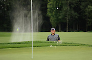 Notah Begay keeps his eye on the ball after hitting it out of the sand trap towards the 15th hole of the Atunyote Golf Course during The Notah Begay III Foundation Golf Tournament at Turning Stone Resort & Casino's Atunyote Golf Club in Vernona, N.Y., Wednesday, August 27, 2014.<br /> (AP/Heather Ainsworth)