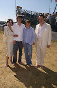 Isabella Blow, Tara Ferry and Merlin Ferry and Detmar Blow. Veuve Clicquot Gold Cup Final at Cowdray Park. Midhurst. 17 July 2005. ONE TIME USE ONLY - DO NOT ARCHIVE  © Copyright Photograph by Dafydd Jones 66 Stockwell Park Rd. London SW9 0DA Tel 020 7733 0108 www.dafjones.com