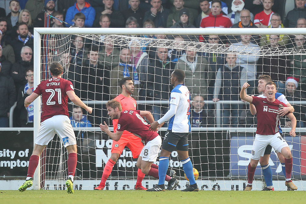 Northampton Town's Sam Foley celebrates scoring his sides first goal  beating Blackburn Rovers keeper David Raya<br /> <br /> Photographer Mick Walker/CameraSport<br /> <br /> The EFL Sky Bet League One - Northampton Town v Blackburn Rovers - Saturday 23rd December 2017 - Sixfields Stadium - Northampton<br /> <br /> World Copyright © 2017 CameraSport. All rights reserved. 43 Linden Ave. Countesthorpe. Leicester. England. LE8 5PG - Tel: +44 (0) 116 277 4147 - admin@camerasport.com - www.camerasport.com