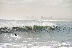 Surfers enjoyed the unusually high waves in Gordon's Bay, in the Western Cape, Tuesday afternoon, July 14, 2020, after gale force winds and flash floods had beaten the coast for several days. PHOTO: EVA-LOTTA JANSSON