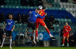 TALLINN, ESTONIA - Monday, October 11, 2021: Wales' Kieffer Moore challenges with his arms by his sides for a header with Estonia's Joonas Tamm during the FIFA World Cup Qatar 2022 Qualifying Group E match between Estonia and Wales at the A. Le Coq Arena. Wales won 1-0. (Pic by David Rawcliffe/Propaganda)