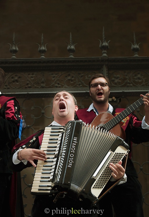 Street musicians play traditional Italian music in the streets near the Piazza del Campo